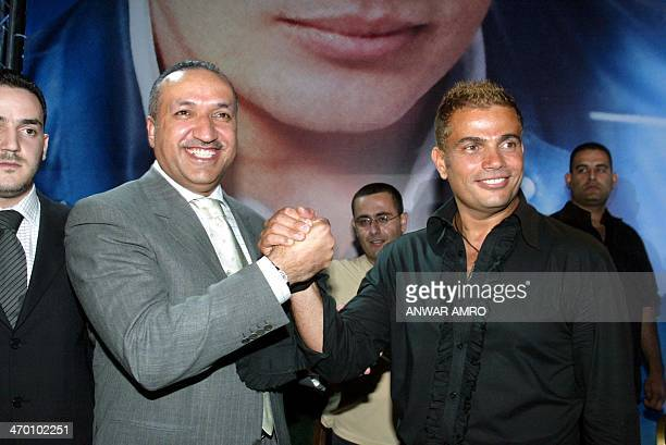 Egyptian pop star Amro Diab and Salem alHindi director general of Rotana announce their agreement late 22 May 2003 in Beirut Diab will join Rotana a...