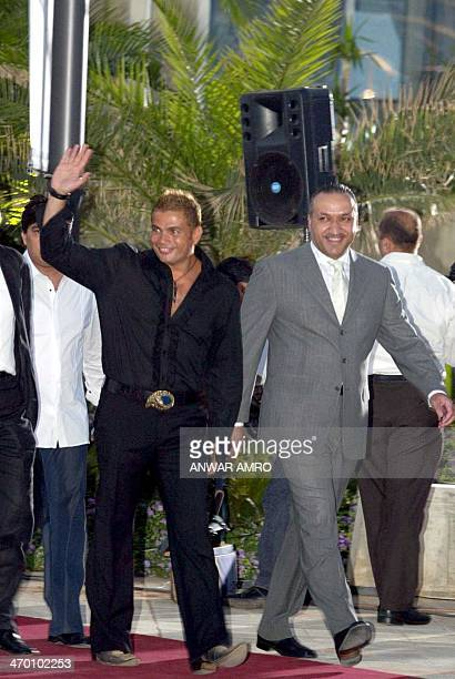 Egyptian pop star Amro Diab and Salem alHindi director general of Rotana arrive late 22 May 2003 in Beirut Diab will join Rotana a musical production...