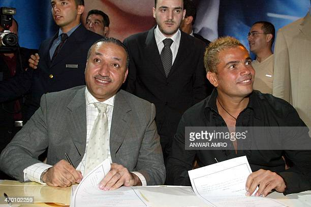 Egyptian pop star Amro Diab and Salem alHindi director general of Rotana sign an agreement late 22 May 2003 in Beirut Diab will leave his previous...