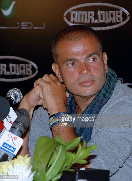 Egyptian pop star Amro Diab holds a press conference to announce signing a contract with the Rotana label in Cairo late on June 27 2008 The Gulfbased...