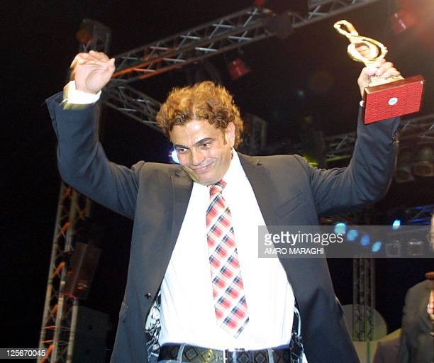 Egyptian pop star Amro Diab jubilates after receiving the Golden Lion prize at the Arab Radio and Television festival 04 August 2002 in Cairo AFP...