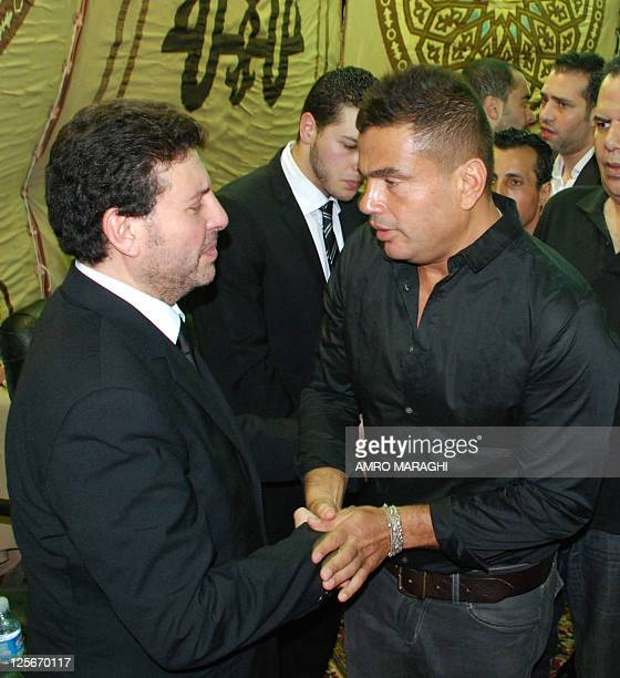 Egyptian pop star Amro Diab pays his condolences to fellow pop star Hani Shaker on June 24 2011 in Cairo following the death of his daughter Dena who...