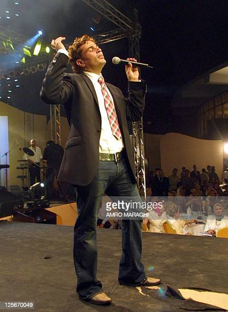 Egyptian pop star Amro Diab performs during the Arab Radio and Television festival 04 August 2002 in Cairo AFP PHOTO/Amro MARAGHI