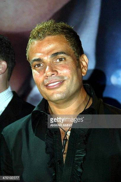 Egyptian pop star Amro Diab poses for photographers late 22 May 2003 in Beirut Diab will join Rotana a musical production company owned by Saudi...