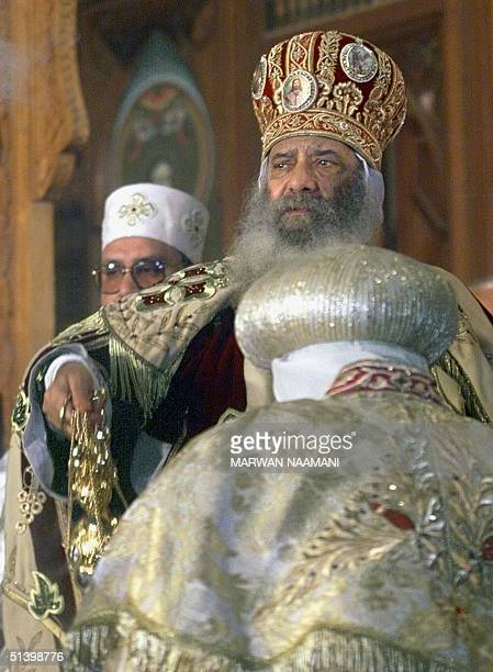 Egyptian Pope Shenouda III conducts the Coptic midnight mass 07 January 2000 at Cairo's Saint Murkos church The death of 18 Copts during clashes last...