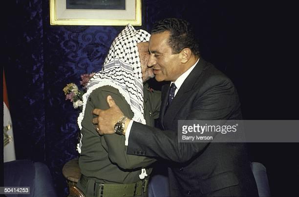 Egyptian Pres Husni Mubarak hugging Palestine Liberation Organization chairman Yasser Arafat