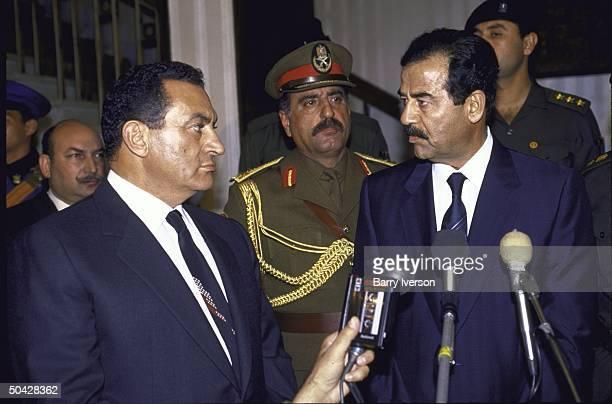 Egyptian Pres Husni Mubarak meeting with Iraqi Pres Saddam Hussein