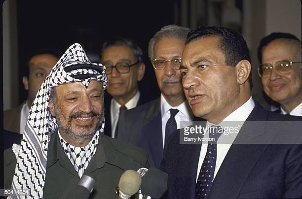 Egyptian Pres Husni Mubarak standing with Palestine Liberation Organization leader Yasser Arafat