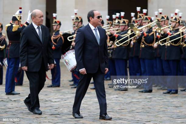 Egyptian President Abdel Fattah al-Sisi and French Foreign Affairs Minister Jean-Yves Le Drian attend a military ceremony at the Hotel des Invalides...