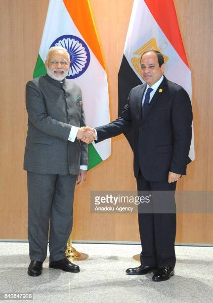 Egyptian President Abdel Fattah alSisi and Indian Prime Minister Narendra Modi shake hands during the Brazil Russia India China and South Africa...