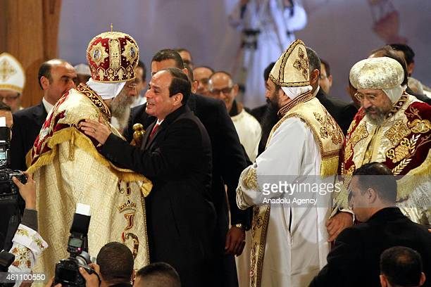 Egyptian President Abdel Fattah alSisi attends a Christmas Eve mass led by Egyptian Coptic Pope Tawadros II at the St Mark's Coptic Orthodox...
