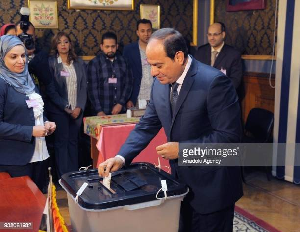 Egyptian President Abdel Fattah alSisi casts his ballot during the Egypts presidential election at the Mustafa Yousry Amira secondary school in Cairo...