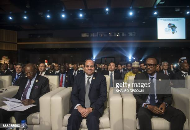 Egyptian President Abdel Fattah alSisi Guinea's President and African Union chairman Alpha Conde and Rwandan President Paul Kagame attend the opening...