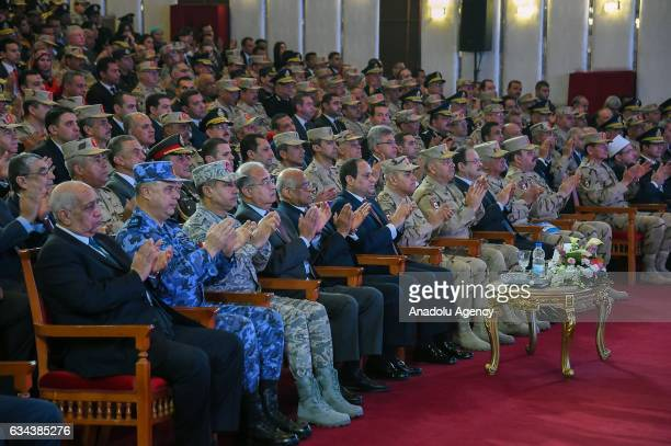 Egyptian President Abdel Fattah alSisi Prime Minister of Egypt Sherif Ismail Mohamed Egyptian Minister of Defence Sedki Sobhy and other military and...