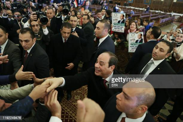 Egyptian President Abdel Fattah al-Sisi shakes hands as he arrives to offer congratulations for Coptic Pope Tawadros II , and Coptic Christians...