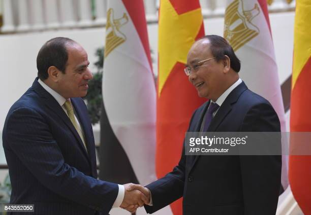 Egyptian President Abdel Fattah al-Sisi shakes hands with Vietnamese Prime Minister Nguyen Xuan Phuc as they meet in Hanoi on September 7, 2017. The...