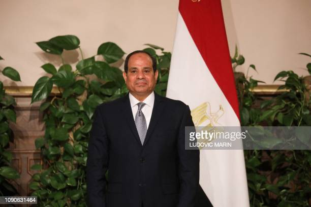 Egyptian President Abdel Fattah AlSisi stands in front of an Egyptian flag as various Egyptian and French ministers sign cooperation agreements at...