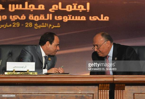 Egyptian President Abdel Fattah alSisi talks to Sameh Shoukry the Egyptian foreign minister during the Arab League summit at the Red Sea resort of...
