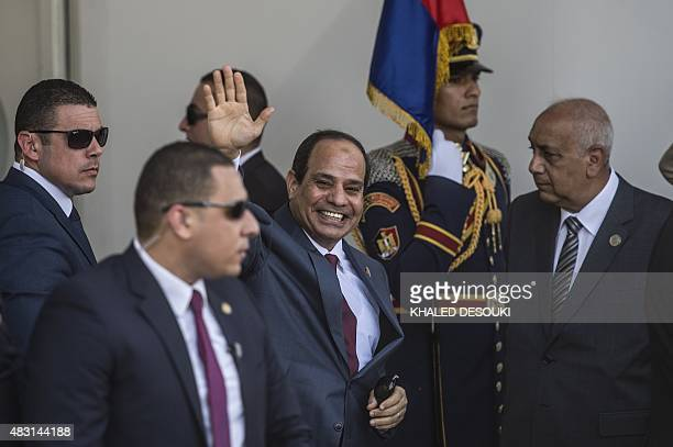 Egyptian President Abdel Fattah alSisi waves as he arrives for the opening ceremony of a new waterway at the Suez Canal on August 6 in the port city...