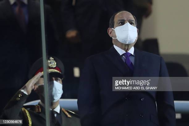 Egyptian president Abdel Fattah al-Sisi, wearing a protective mask, stands in grandstand before the opening match of the 2021 World Men's Handball...