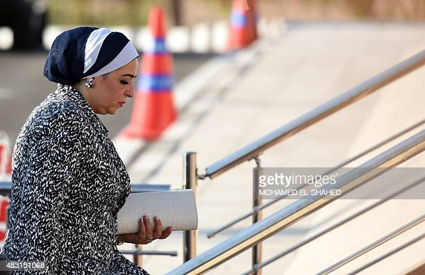 Egyptian President Abdel Fattah alSisi's wife Entissar Amer arrives for the opening ceremony of a new waterway at the Suez Canal on August 6 in the...