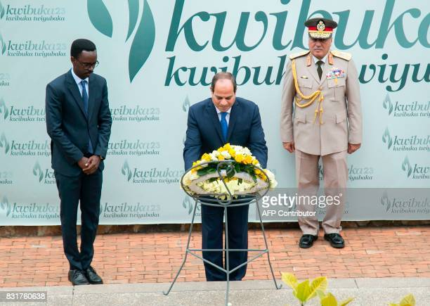 Egyptian President Abdel Fattah AlSissi is watched by officials as he lays a wreath at The Kigali Genocide Memorial in Kigali on August 15 shortly...