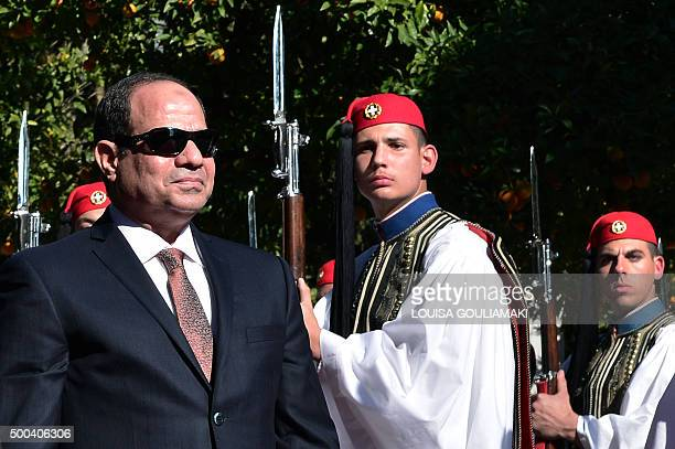 Egyptian president Abdel Fattah alSissi reviews an honour guard during an official welcoming ceremony outside the Presidental palace in Athens on...