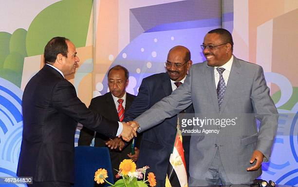 Egyptian President Abdel Fattah elSisi and Ethiopian Prime Minister Hailemariam Desalegn shake hands during the signing ceremony of Nahda Dam in...