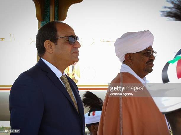 Egyptian President Abdel Fattah elSisi is welcomed by President of Sudan Omar alBashir R upon his arrival at Khartoum Airport Sudan to attend...