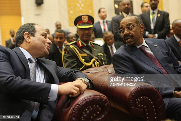 Egyptian President AbdelFattah alSisi chats with Sudanese President Omar alBashir during a meeting in the Sudanese capital Khartoum on March 23 2015...