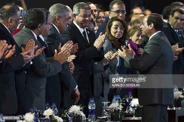 Egyptian President AbdelFattah alSisi is is applauded as he arrives to the Egypt economic development conference at the congress hall in the Red Sea...