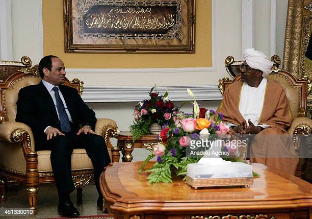 Egyptian President AbdelFattah alSisi meets with Sudanese President Omar alBashir in Khartoum Sudan on June 27 2014 AlSisi is expected to talk with...