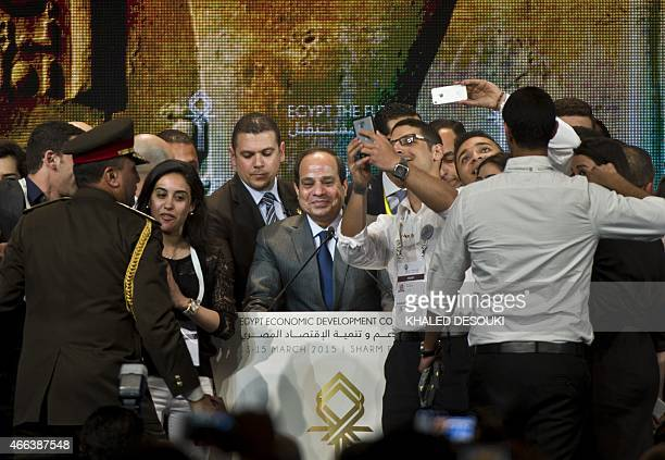 Egyptian President AbdelFattah alSisi poses for selfie pictures prior to giving a speech at the end of the Egypt economic development conference at...