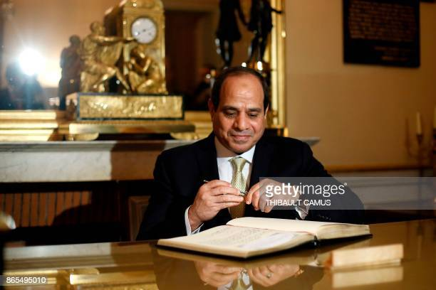 Egyptian President AbdelFattah alSisi signs a guest book prior to a meeting with French Defence Minister Florence Parly at The Defence Ministry in...