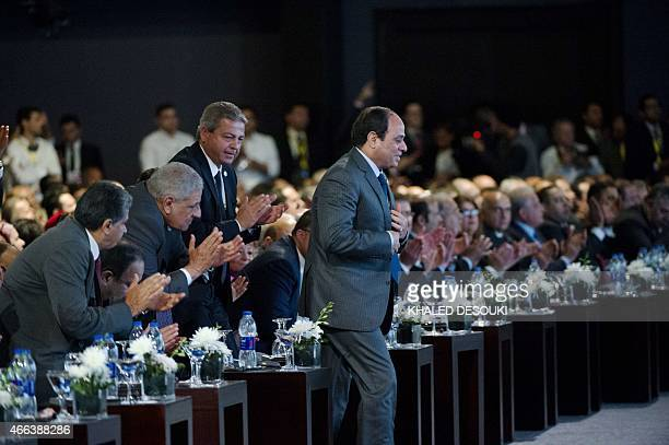 Egyptian President AbdelFattah alSisi walks to give a speech at the end of the Egypt economic development conference at the congress hall in the Red...