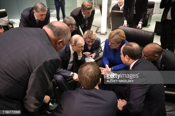 Egyptian President Abdul Fattah alSisi Russian President Vladimir Putin German Chancellor Angela Merkel and French President Emmanuel Macron talk on...