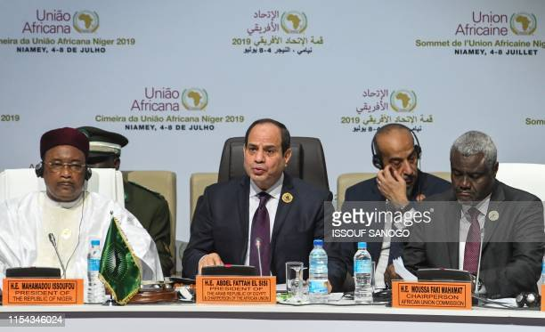 Egyptian President and African Union Chairman Abdel Fattah alSisi delivers a speech next to Niger's president Mahamadou Issoufou and African Union...