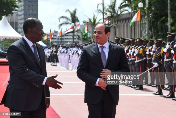 Egyptian President and African Union Chairman Abdel Fattah al-Sisi is welcomed by Ivorian President Alassane Ouattara at the presidential palace in...