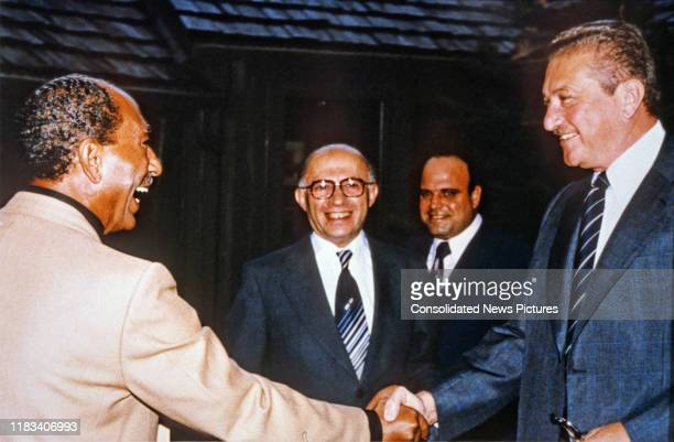 Egyptian President Anwar Al Sadat and Israeli Defense Minister Ezer Weizman shake hands during the Egyptian-Israeli peace negotiations at Camp David,...