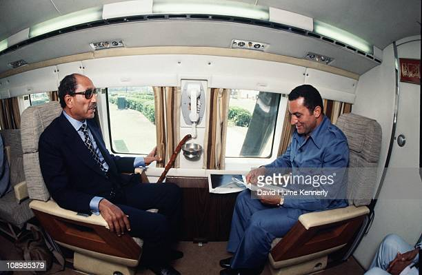 Egyptian president Anwar al Sadat speaks with Vice President Hosni Mubarak after the Egyptian presidential helicopter landed in Alexandria, after...