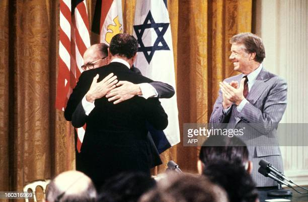 Egyptian President Anwar al-Sadat and Israeli Premier Menachem Begin embrace each other, on September 17 after signing a peace agreement in the East...