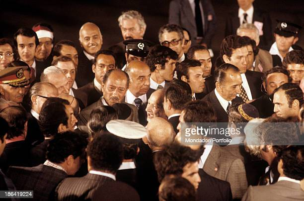 Egyptian president Anwar alSadat is surrounded by the crowd Jerusalem November 1977