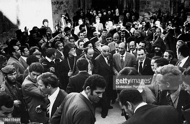 Egyptian president Anwar alSadat walking surrounded by the crowd Jerusalem November 1977