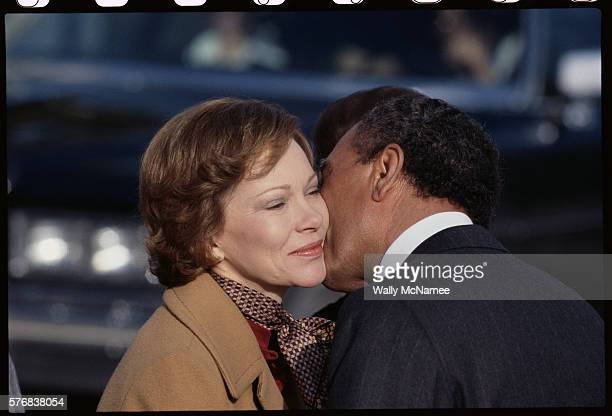 Egyptian President Anwar elSadat kisses First Lady Rosalynn Carter as he departs from the White House
