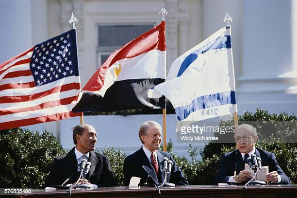 Egyptian President Anwar elSadat US President Jimmy Carter and Israeli Prime Minister Menachem Begin at a peace conference