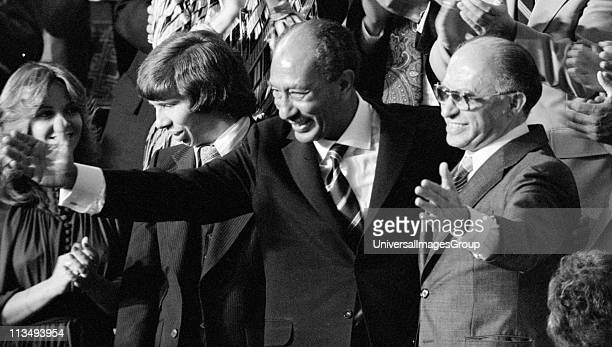 Egyptian President Anwar Sadat and Israeli Prime Minister Menachem Begin acknowledge applause during a Joint Session of Congress in which President...