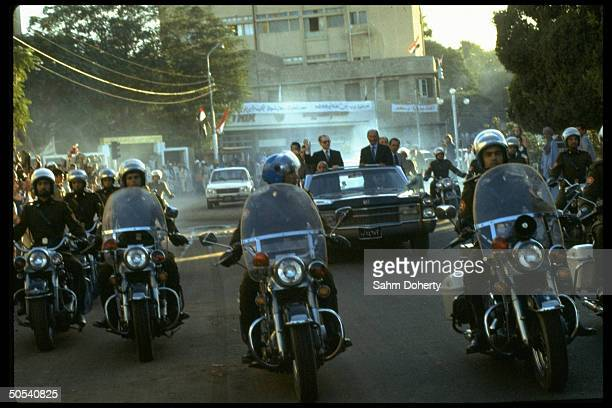 Egyptian President Anwar Sadat and the Shah of Iran in motorcade upon the Shah's arrival to Cairo.