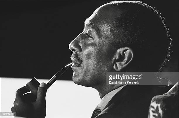 Egyptian President Anwar Sadat attends the successful conclusion of the Sinai II negotiations in 1975 in Alexandria Egypt