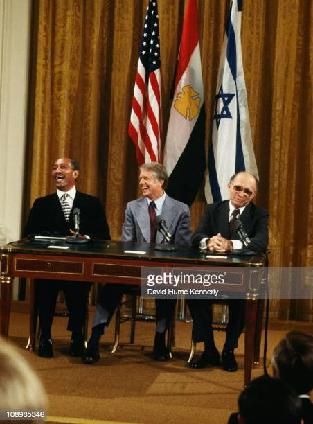 Egyptian President Anwar Sadat US President Jimmy Carter and Israeli Prime Minister Menachem Begin enjoy a moment of levity during the Camp David...