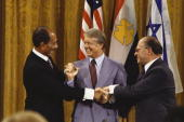 Egyptian president anwar sadat us president jimmy carter and israeli picture id1826042?s=170x170
